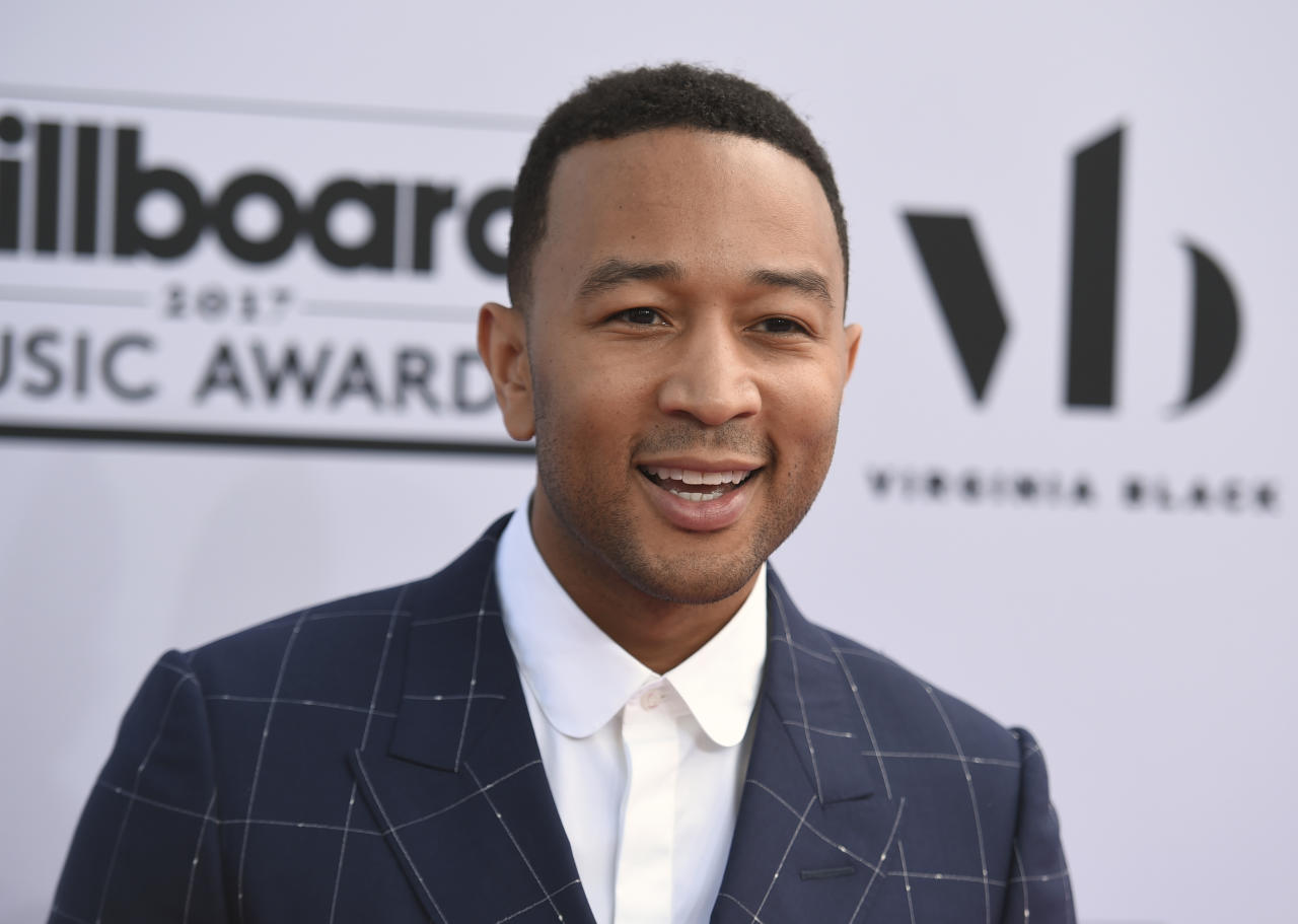 "FILE - In this May 21, 2017 photo, John Legend arrives at the Billboard Music Awards at the T-Mobile Arena in Las Vegas. Legend's work has won Grammys, an Oscar and a Tony, but years before achieving global fame, the Legend-to-be took home another prize: spelling bee champ. A 1989 story in The Springfield News-Sun proclaimed, ""Product of home teaching wins bee."" The newspaper said the 10-year-old Legend took a no-nonsense approach, not cracking a smile during the competition until his tutor cried out in joy when he correctly spelled the winning word: prejudice. (Photo by Richard Shotwell/Invision/AP, File)"