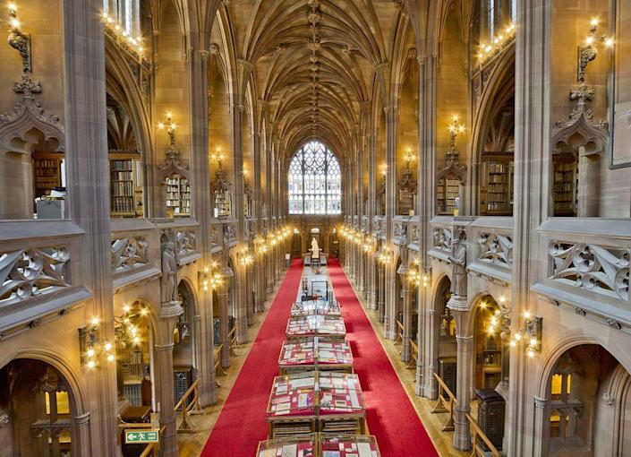 """<p>The <a href=""""https://www.library.manchester.ac.uk/rylands/"""" rel=""""nofollow noopener"""" target=""""_blank"""" data-ylk=""""slk:University of Manchester's Gothic masterpiece"""" class=""""link rapid-noclick-resp"""">University of Manchester's Gothic masterpiece</a> was named after the owner of Britain's largest textile manufacturer and the city's first multimillionaire, John Rylands. </p><p>Commissioned in 1889, the cathedral-like structure blends traditional Gothic architecture with modern Art Nouveau metalwork and hints of Arts and Crafts decorative details. Today, the library houses a vast collection of rare books and more than a million manuscripts. </p>"""
