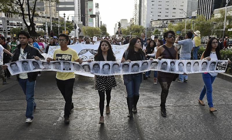 Protesters march during a demostration in Mexico City on October 8, 2014, demanding justice for 43 students that went missing in Iguala, Guerrero state, on September 26 (AFP Photo/Ronaldo Schemidt)
