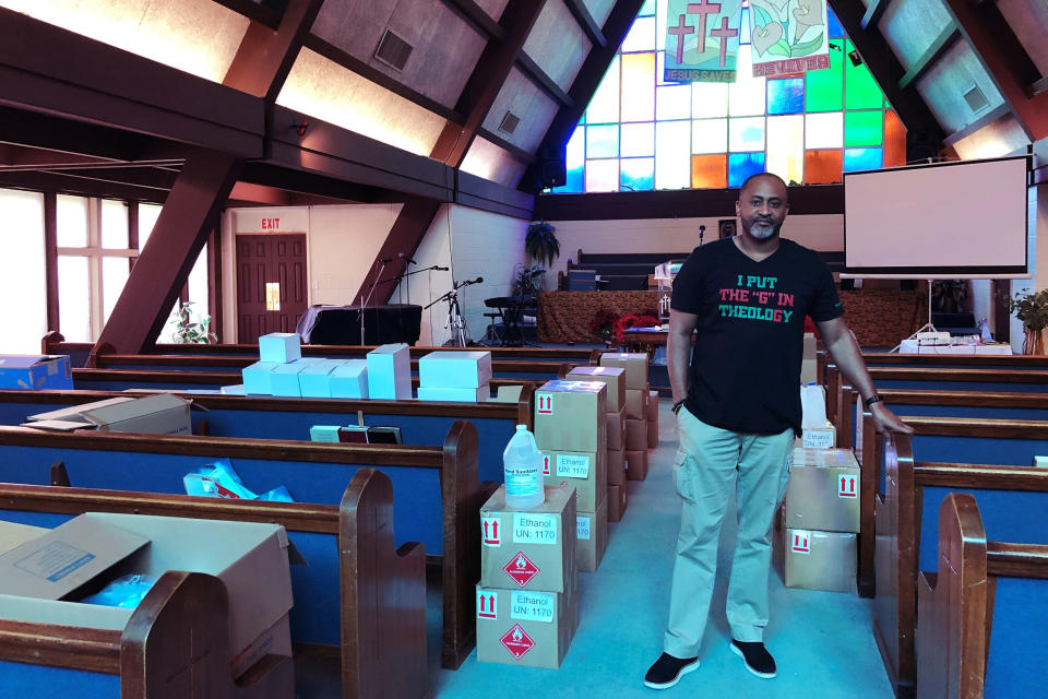 Earle Fisher, a pastor and civil rights activist, poses inside Abyssinian Missionary Baptist Church on Sunday, July 12, 2020, in Memphis, Tenn. Fisher is a plaintiff in a lawsuit seeking to open up mail-in voting to all eligible voters in Tennessee. (AP Photo/Adrian Sainz)