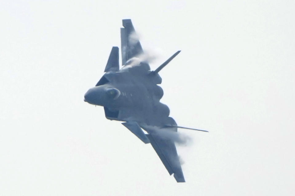 A J-20 stealth fighter jet of the Chinese People's Liberation Army (PLA) Air Force performs during the 13th China International Aviation and Aerospace Exhibition, also known as Airshow China 2021, on Tuesday, Sept. 28, 2021 in Zhuhai in southern China's Guangdong province. (AP Photo/Ng Han Guan)