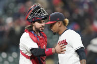 Cleveland Indians catcher Austin Hedges, left, congratulates relief pitcher Emmanuel Clase after the Indians defeated the Chicago Cubs 3-2 in a baseball game, Tuesday, May 11, 2021, in Cleveland. (AP Photo/Tony Dejak)