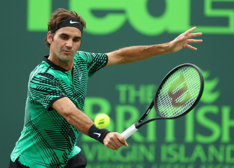 Roger Federer of Switzerland returns a shot against Frances Tiafoe during day 6 of the Miami Open at Crandon Park Tennis Center on March 25, 2017 in Key Biscayne, Florida