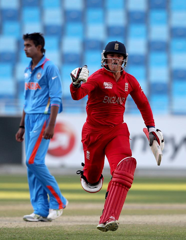 DUBAI, UNITED ARAB EMIRATES - FEBRUARY 22:  Robert Jones of England celebrate after winning the ICC U19 Cricket World Cup 2014 Quarter Final match between England and India at the Dubai Sports City Cricket Stadium on February 22, 2014 in Dubai, United Arab Emirates.  (Photo by Francois Nel - IDI/IDI via Getty Images)