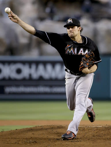 Miami Marlins starting pitcher Nathan Eovaldi throws against the Los Angeles Angels during the first inning of a baseball game in Anaheim, Calif., Tuesday, Aug. 26, 2014. (AP Photo/Chris Carlson)