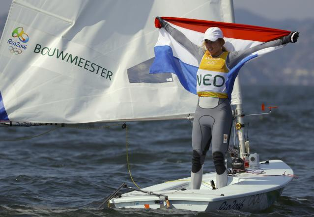 2016 Rio Olympics - Sailing - Final - Women's One Person Dinghy - Laser Radial - Medal Race - Marina de Gloria - Rio de Janeiro, Brazil - 16/08/2016. Marit Bouwmeester (NED) of Netherlands celebrates gold medal. REUTERS/Brian Snyder TPX IMAGES OF THE DAY FOR EDITORIAL USE ONLY. NOT FOR SALE FOR MARKETING OR ADVERTISING CAMPAIGNS.