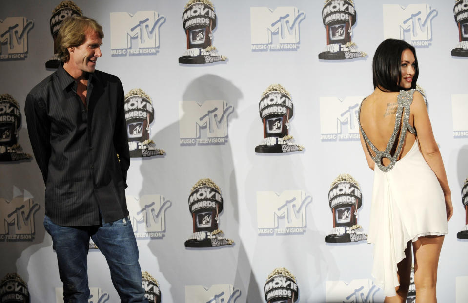 """""""Transformers"""" director Michael Bay look on as actress Megan Fox poses backstage for photographers at the MTV Movie Awards in Los Angeles, Sunday, June 1, 2008. (AP Photo/Chris Pizzello)"""