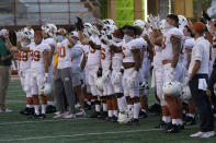 """Texas players sing """"The Eyes Of Texas"""" after an NCAA college football game against Baylor in Austin, Texas, Saturday, Oct. 24, 2020. (AP Photo/Chuck Burton)"""