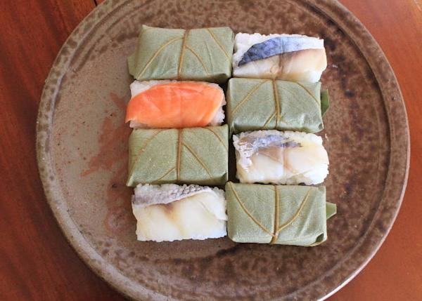 Sushi wrapped in Japanese persimmon leaves