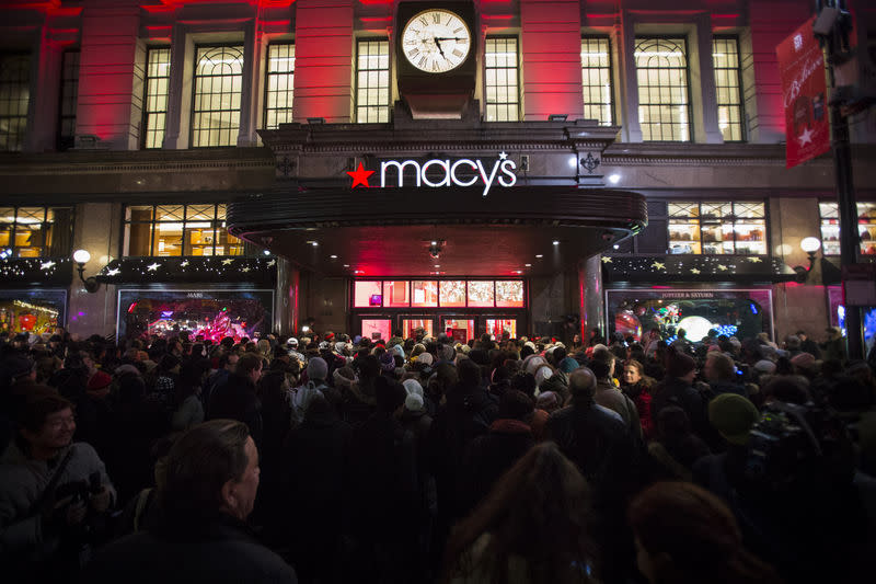 Shoppers wait to enter Macy's to kick off Black Friday sales in New York