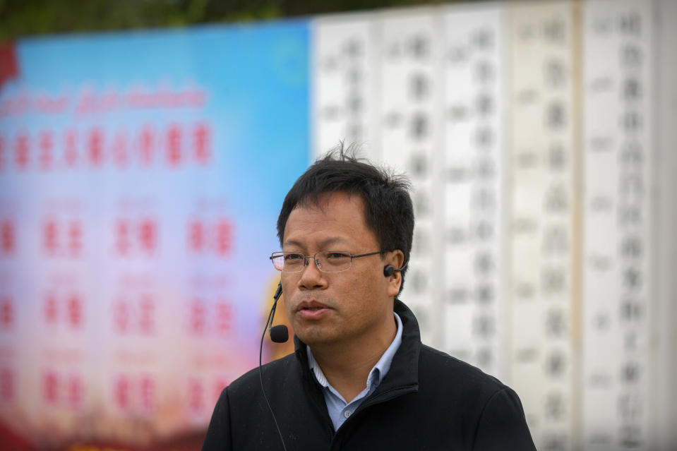 "Xu Guixiang, deputy director-general of the Communist Party's publicity department in Xinjiang, speaks outside a location that was identified in early 2020 as a re-education facility by an Australian think tank, which the Chinese government asserts is currently home to a veterans' affairs bureau and other offices, in Turpan in western China's Xinjiang Uyghur Autonomous Region during a government organized trip for foreign journalists, Thursday, April 22, 2021. A spokesperson for the Xinjiang region called accusations of genocide ""totally groundless"" as the British parliament approved a motion Thursday that said China's policies amounted to genocide and crimes against humanity. (AP Photo/Mark Schiefelbein)"