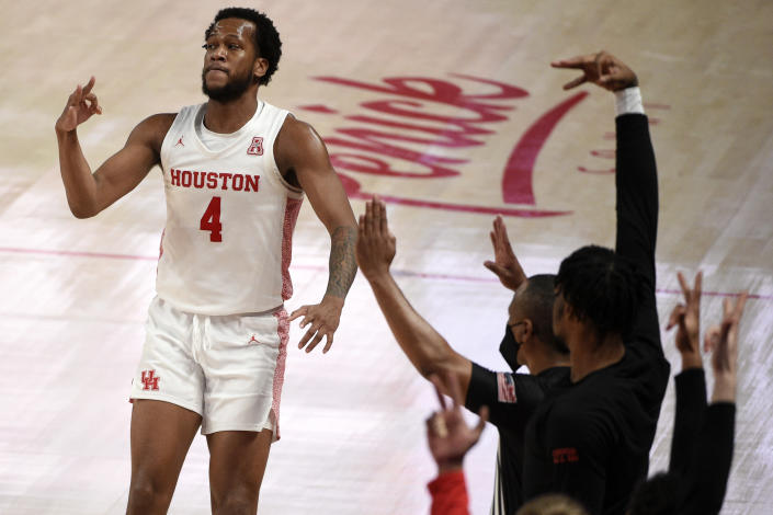 Houston forward Justin Gorham (4) reacts assert making a 3-point basket during the second half of an NCAA college basketball game against Cincinnati, Sunday, Feb. 21, 2021, in Houston. (AP Photo/Eric Christian Smith)