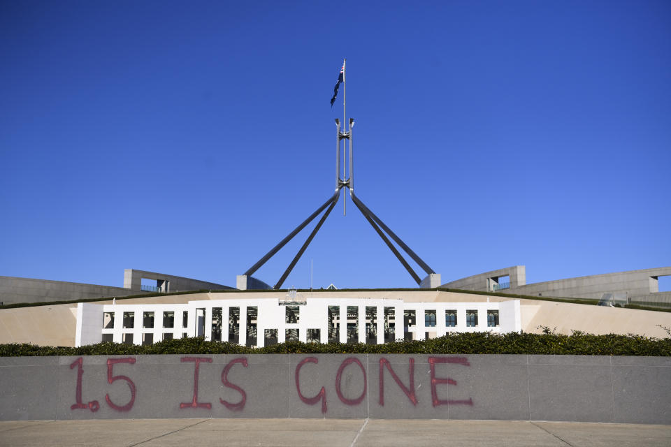 Climate protesters defaced Parliament House on Tuesday.