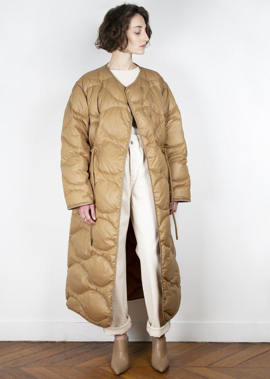 """<br><br><strong>The Frankie Shop</strong> Collarless Tan Quilted Nylon Coat, $, available at <a href=""""https://thefrankieshop.com/collections/outerwear/products/collarless-tan-quilted-nylon-coat"""" rel=""""nofollow noopener"""" target=""""_blank"""" data-ylk=""""slk:The Frankie Shop"""" class=""""link rapid-noclick-resp"""">The Frankie Shop</a>"""
