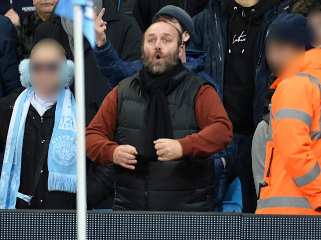 A Manchester City fan allegedly aimed a racial gesture at Manchester United players: EPA