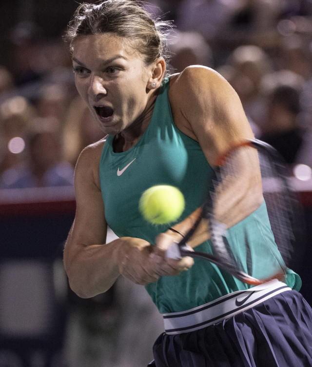Simona Halep, of Romania, returns to Venus Williams, of the United States, during the Rogers Cup womens tennis tournament Thursday, Aug. 9, 2018, in Montreal. (Paul Chiasson/The Canadian Press via AP)