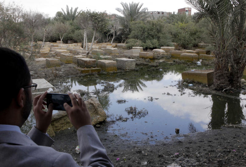 An Egyptian reporter photographs damaged tombs and fetid water at the Jewish cemetery, in Cairo, Egypt, Thursday, April 18, 2013. The leader of Egypt's dwindling and aging Jewish community, known for her tireless work preserving synagogues and a once-sprawling Jewish cemetery, died Saturday at the age of 82. Carmen Weinstein was buried Thursday in the Bassatine cemetery she herself worked to save since 1978. It is the only Jewish cemetery left in Cairo and is the largest in Egypt. The transformation of Bassatine mirrors the dramatic changes Egypt has undergone as its population skyrocketed and poverty grew. Parts of Bassatine were turned into a garbage dump, while another area was seized by antiquities' officials. Weinstein was able to preserve a small area as a Jewish cemetery.  (AP Photo/ Amr Nabil)