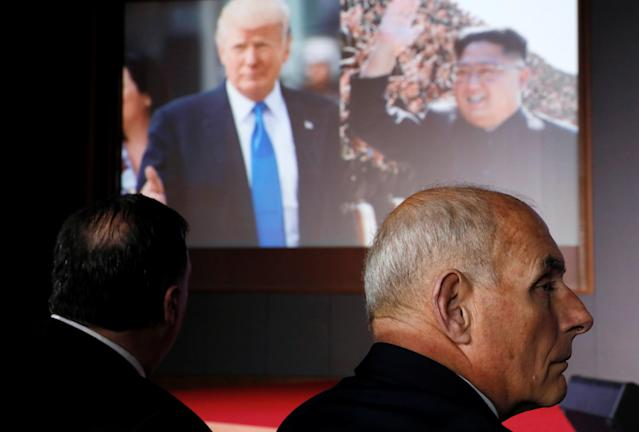 <p>Secretary of State Mike Pompeo and White House Chief of Staff John Kelly listen as President Donald Trump speaks during a news conference after his meeting with North Korean leader Kim Jong Un at the Capella Hotel on Sentosa island in Singapore, June 12, 2018. (Photo: Jonathan Ernst/Reuters) </p>