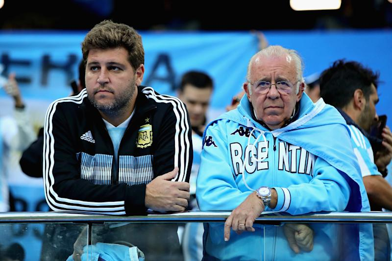Down and nearly out: Argentina fans in Nizhny Novgorod look glum after their side's shock defeat. (Getty)