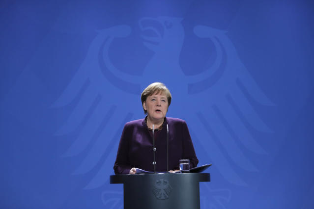 Chancellor Angela Merkel speaks during a news conference about German government measures to curb it (AP)