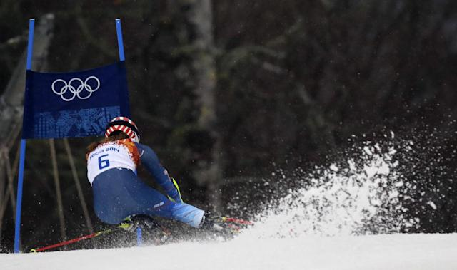 United States' Mikaela Shiffrin approaches a gate in the first run in the women's giant slalom at the Sochi 2014 Winter Olympics, Tuesday, Feb. 18, 2014, in Krasnaya Polyana, Russia. (AP Photo/Luca Bruno)