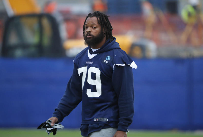 Dallas Cowboys defensive lineman Michael Bennett (79) walks onto the field for an NFL football team practice in Frisco, Texas, Tuesday, Oct. 29, 2019. The Cowboys acquired Bennett from the New England Patriots for a conditional late-round draft pick in 2021. (AP Photo/LM Otero)