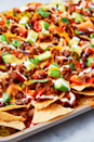 """<p>Is there anything more satisfying than a loaded tray of <a href=""""https://www.delish.com/uk/cooking/recipes/a30386864/instant-pot-nachos-recipe/"""" rel=""""nofollow noopener"""" target=""""_blank"""" data-ylk=""""slk:nachos"""" class=""""link rapid-noclick-resp"""">nachos</a>, still hot from the oven? They are the PERFECT weekend treat and they couldn't be any easier to make! This recipe is foolproof and sure to be delicious, but feel free to mix and match with your favourite ingredients.</p><p>Get the <a href=""""https://www.delish.com/uk/cooking/recipes/a28895357/nachos-supreme-recipe/"""" rel=""""nofollow noopener"""" target=""""_blank"""" data-ylk=""""slk:Nachos Supreme"""" class=""""link rapid-noclick-resp"""">Nachos Supreme</a> recipe.</p>"""