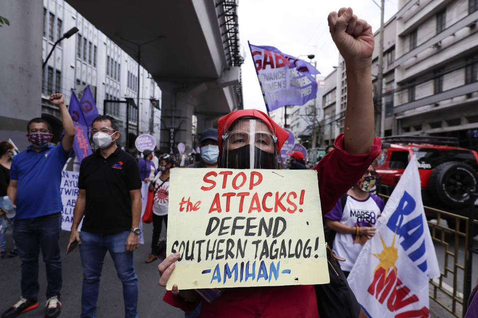 A woman activist displays a slogan condemning the recent government attacks on activists as they hold a rally near the Malacanang presidential palace to mark International Women's Day on Monday March 8, 2021 in Manila, Philippines. Philippine police backed by military forces killed nine people over the weekend in a series of raids against suspected communist insurgents, with authorities saying the suspects opened fire first. Others, however, said those killed were unarmed activists. (AP Photo/Aaron Favila)