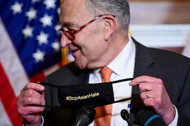 Senate Majority Leader Chuck Schumer displays his '#StopAsianHate' mask at a news conference after the Senate passed the COVID-19 Hate Crimes Act on April 22, 2021.  (Erin Scott/Reuters)