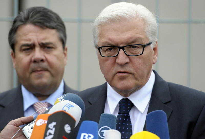 Faction leader of the oppositional German Social Democrats, SPD, Frank-Walter Steinmeier, right, and Head of the SPD Sigmar Gabriel, left, speak to the media after negotiations with the coalition government in Berlin, Germany, Thursday, June 21, 2012. They say they've reached a deal with Chancellor Angela Merkel's governing coalition that will allow them to ratify Europe's budget discipline pact. Merkel needs opposition support to secure the needed two-thirds majority in Parliament for the pact. (AP Photo/dapd Michael Gottschalk)