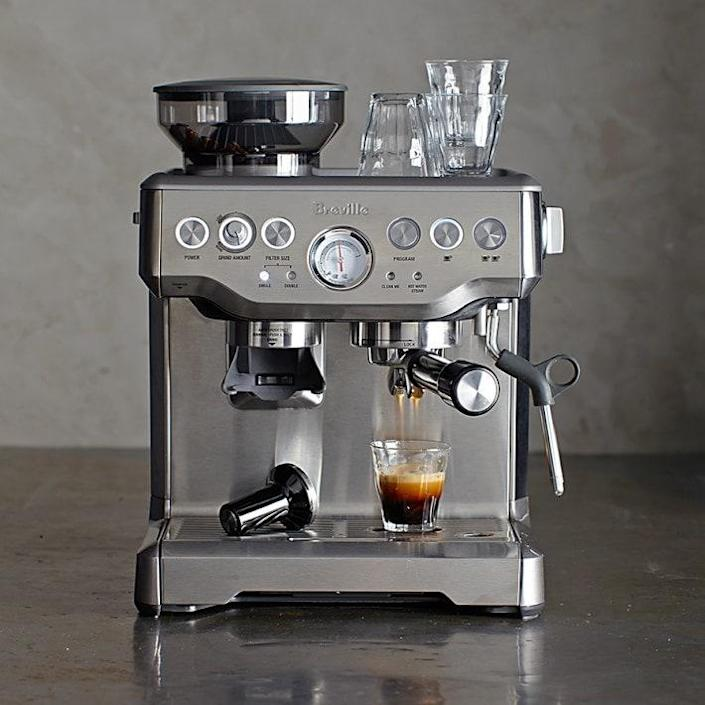 """Save Dad a daily trip to the <a href=""""https://www.architecturaldigest.com/gallery/26-coffee-makers-for-every-type-of-coffee-drinker?mbid=synd_yahoo_rss"""" rel=""""nofollow noopener"""" target=""""_blank"""" data-ylk=""""slk:coffee"""" class=""""link rapid-noclick-resp"""">coffee</a> shop with this 15-setting espresso machine that has over 300 five-star reviews. Whether he's a novice or a pro at espresso, the Breville has both automatic and manual settings to ensure it's easy to use and features like a built-in water filter and steam wand/milk frother that help deliver a top-notch cup of espresso every time. $700, Williams Sonoma. <a href=""""https://www.williams-sonoma.com/products/breville-barista-express-espresso-maker/"""" rel=""""nofollow noopener"""" target=""""_blank"""" data-ylk=""""slk:Get it now!"""" class=""""link rapid-noclick-resp"""">Get it now!</a>"""