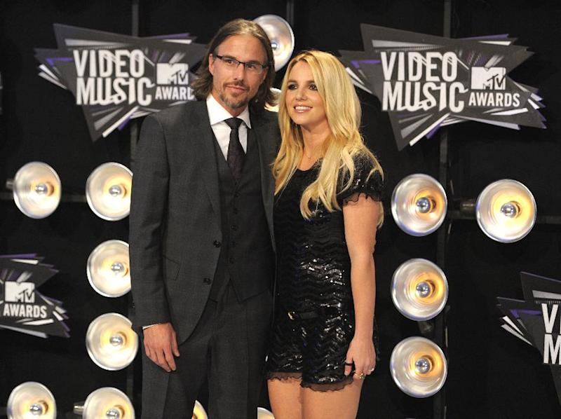 FILE - In this Aug. 28, 2011 file photo, Jason Trawick and Britney Spears arrive at the MTV Video Music Awards in Los Angeles. On Wednesday, April 25, 2012, LA Superior Court Judge Reva Goetz approved Spears' request that her fiance, Jason Trawick, be appointed a co-conservator over her personal affairs. Spears has been under a court-ordered conservatorship since February 2008, when a judge appointed her father and lawyer to manage her personal and financial affiars after several incidents of erratic behavior. (AP Photo/Chris Pizzello, file)