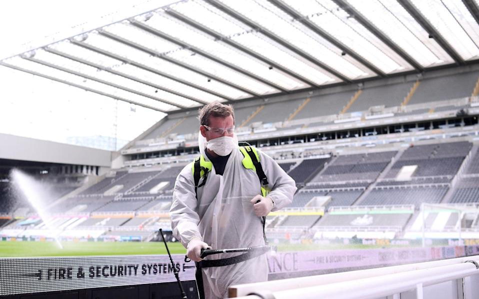Staff disinfect areas inside St James' Park - Getty Images