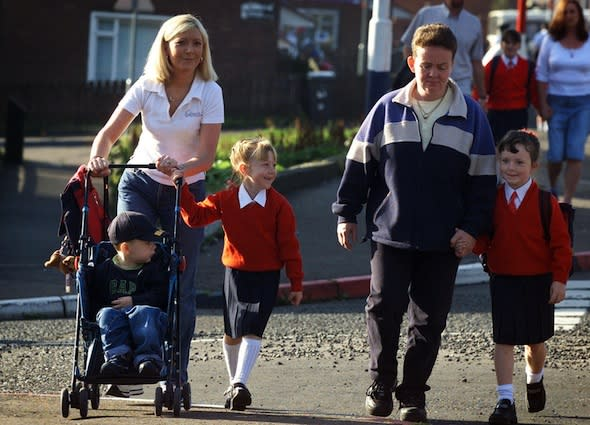 British parents waste £51.2 million a year driving kids under a mile to school