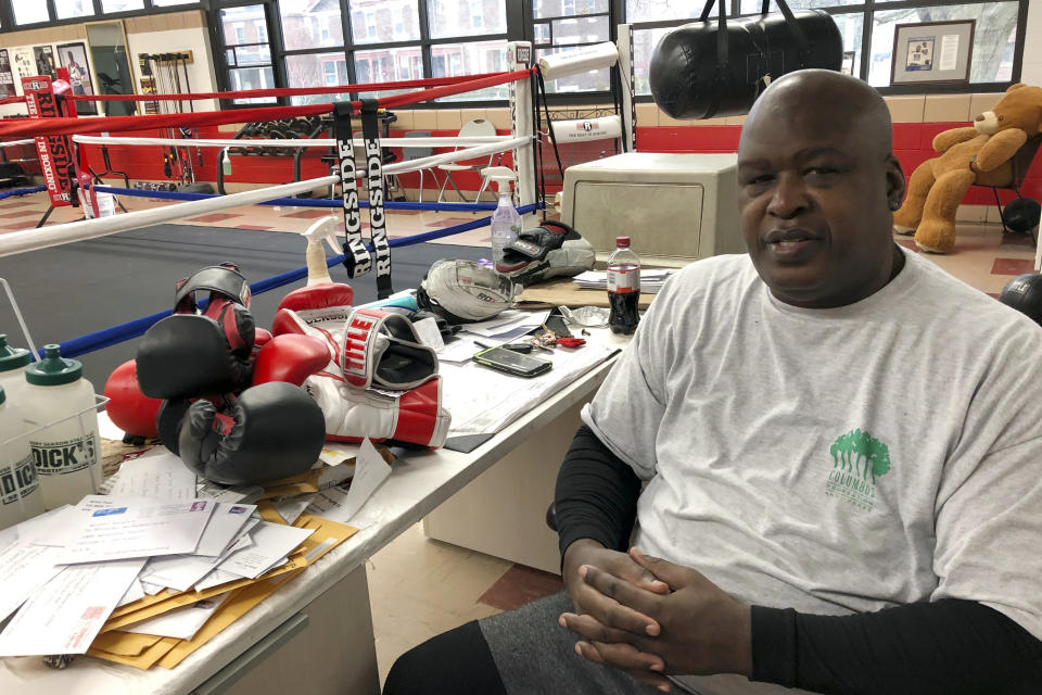 """In this Jan. 31, 2020 photo, James """"Buster"""" Douglas, the former world heavyweight champion, sits at the Thompson Community Center in Columbus, Ohio, where he teaches youth boxing. In one of the more spectacular upsets in sports history, Douglas defeated Mike Tyson, the reigning world heavyweight champion on Feb. 11, 1990, in Tokyo. (AP Photo/Julie Carr Smyth)"""