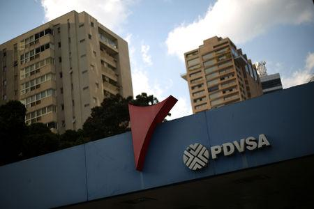 FILE PHOTO: The corporate logo of the state oil company PDVSA is seen at a gas station in Caracas, Venezuela, January 28, 2019. REUTERS/Andres Martinez Casares
