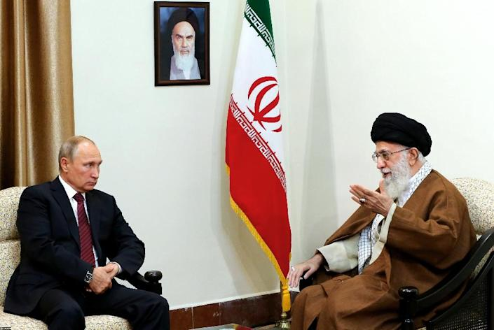 A handout photo provided by the office of Iran's supreme leader Ayatollah Ali Khamenei (R) shows him meeting with Russian president Vladimir Putin in Tehran on November 1, 2017. (AFP Photo/HO)