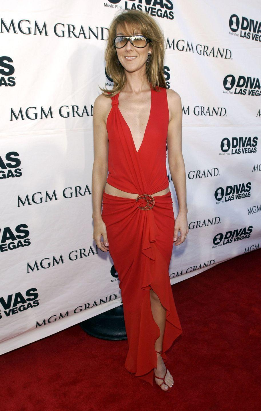 <p>Another skin-baring dress from Dion, and once again, it did not disappoint. The flattering draping and strappy heels are gorgeous, and her signature sunglasses are always a delight.</p>
