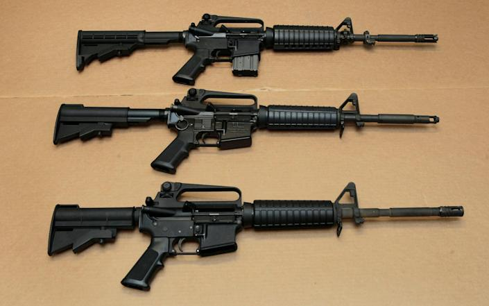 A file photo of AR-15 assault rifles similar to some of those seized in Italy. - Associated Press