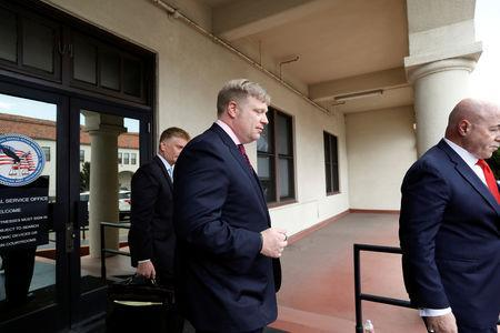 U.S. Navy SEAL Special Operations Chief Edward Gallagher's defense attorney, Timothy Parlatore, (C) leaves the courtroom at a pre-trial hearing for Gallagher who was charged with war crimes in Iraq, in San Diego, U.S. May 22, 2019. REUTERS/Earnie Grafton