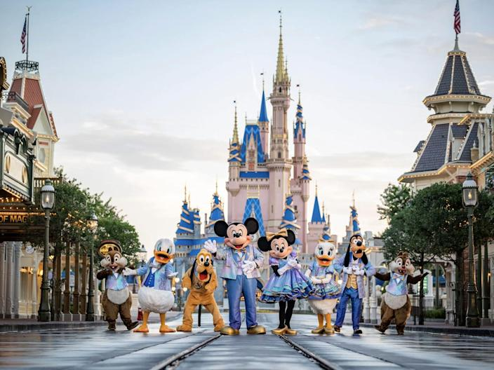 Chip, Dale, Donald, Pluto, Daisy, Mickey, Minnie, and Goofy wear 50th anniversary outfits at Magic Kingdom.