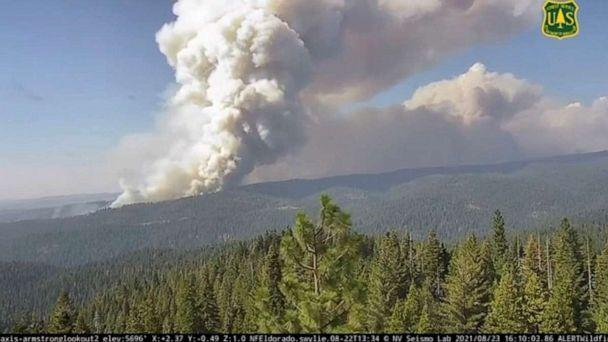 PHOTO: Smoke billows from the Caldor Fire in El Dorado County, Calif., Aug. 23, 2021, in this screen grab taken from a time-lapse released by ALERTWildfire. (ALERTWildfire via Reuters)