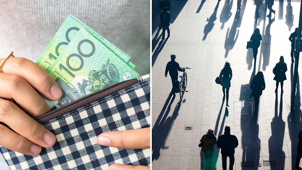 Close up of hands holding purse with Australian $100 notes, silhouetted pedestrians in busy street.
