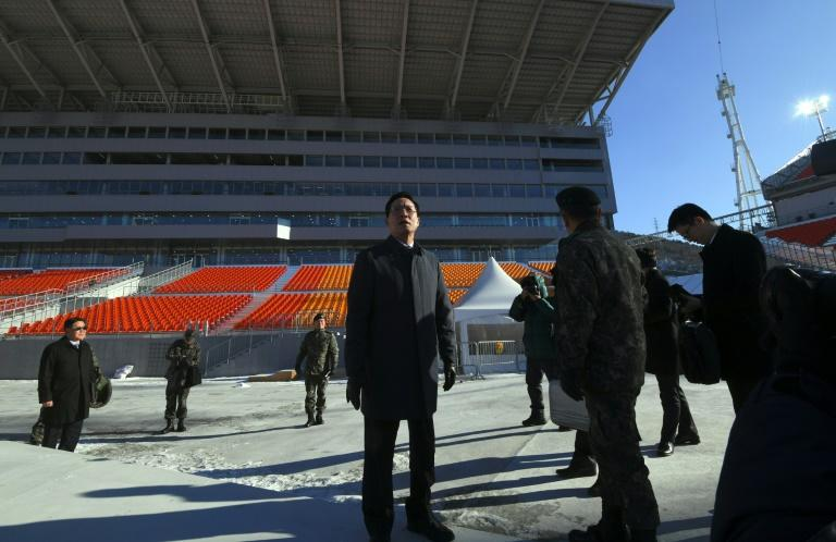 South Korean Defence Minister Song Young-Moo (centre) inspects preparations at the Pyeongchang Olympic Stadium on December 12