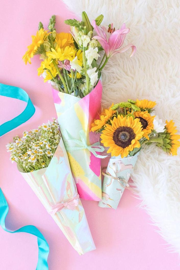 """<p>Presentation is everything, they say! Grab a few of her favorite blooms and some colorful wrapping paper, then get to work crafting this adorable, simple gift. </p><p><strong>Get the tutorial at <a href=""""http://www.clubcrafted.com/2018/05/03/how-to-wrap-a-bouquet-of-flowers-wrapping-paper/"""" rel=""""nofollow noopener"""" target=""""_blank"""" data-ylk=""""slk:Club Crafted"""" class=""""link rapid-noclick-resp"""">Club Crafted</a>.</strong></p><p><strong><a class=""""link rapid-noclick-resp"""" href=""""https://go.redirectingat.com?id=74968X1596630&url=https%3A%2F%2Fwww.walmart.com%2Fsearch%2F%3Fquery%3Dwrapping%2Bpaper&sref=https%3A%2F%2Fwww.thepioneerwoman.com%2Fholidays-celebrations%2Fgifts%2Fg32307619%2Fdiy-gifts-for-mom%2F"""" rel=""""nofollow noopener"""" target=""""_blank"""" data-ylk=""""slk:SHOP WRAPPING PAPER"""">SHOP WRAPPING PAPER</a><br></strong></p>"""