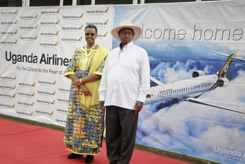 FILE - In this Tuesday, April 23, 2019 file photo, Uganda's President Yoweri Museveni and First Lady Janet Museveni attend a ceremony to mark the arrival of two CRJ-900 jets from Canadian aerospace company Bombardier for Uganda's national carrier Uganda Airlines, at the airport in Entebbe, Uganda. Questions are swirling in Africa and elsewhere over the financial wisdom of sustaining prestige carriers that have a tiny share of an aviation market that sees no recovery in sight as sub-Saharan Africa faces its first recession in a quarter-century amid coronavirus-related travel restrictions. (AP Photo/Ronald Kabuubi, File)