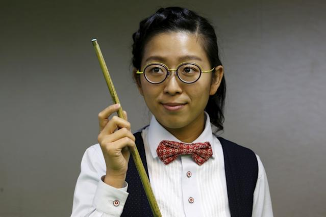 Ng On-yee, 25, 2015 Ladies World Snooker Championship winner, poses during an interview in Hong Kong, China January 27, 2016. A decade after taking up the sport because she liked her father's outfit, Hong Kong's Ng On Yee finds herself on the brink of snooker history as she embarks on a mission to reach the main draw of the men's world championships.Picture taken January 27, 2016. REUTERS/Bobby Yip