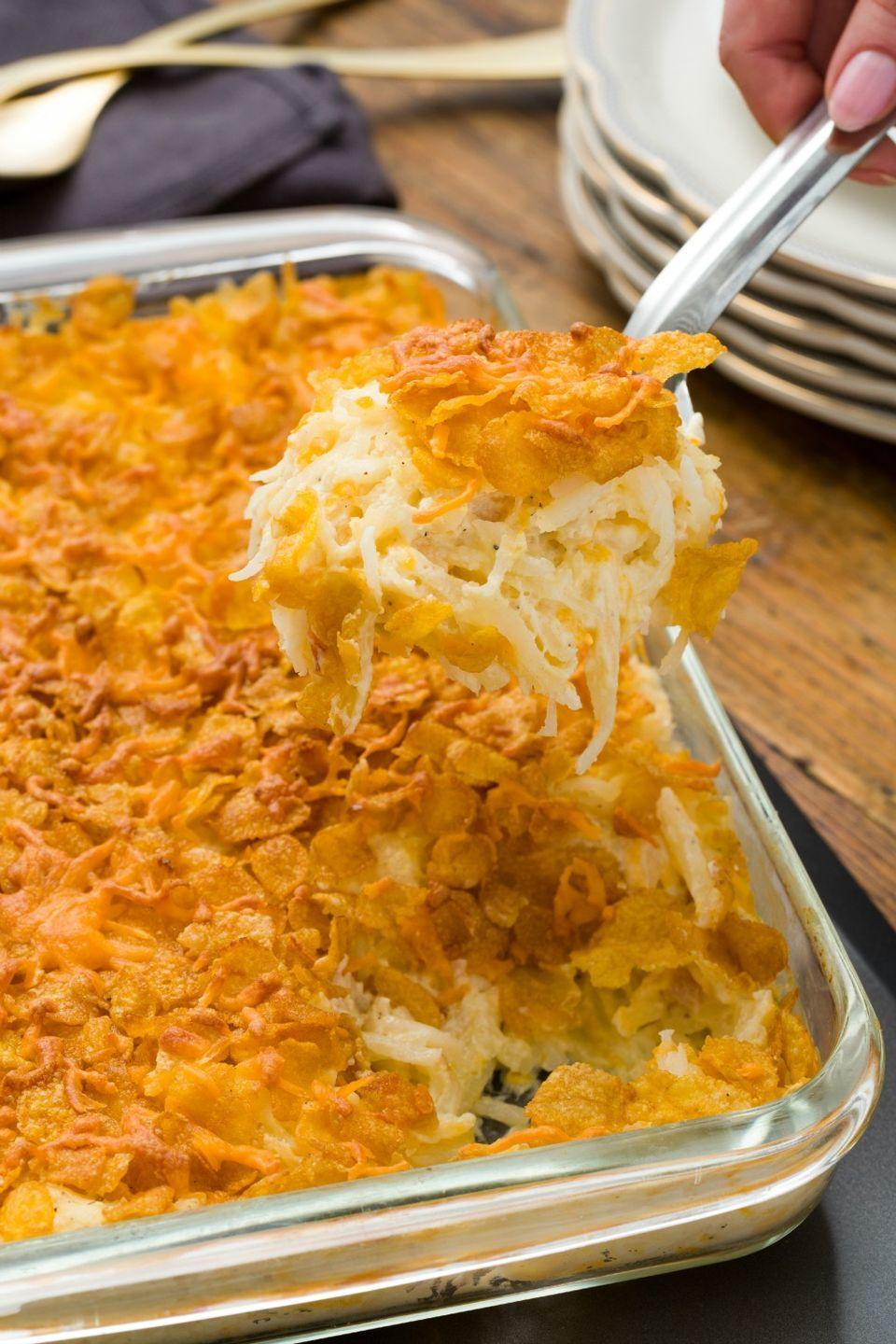 """<p>Crispy, creamy, and cheesy, these potatoes are always a winner in a holiday spread.</p><p>Get the recipe from <a href=""""https://www.delish.com/cooking/recipe-ideas/recipes/a44817/funeral-potatoes-recipe/"""" rel=""""nofollow noopener"""" target=""""_blank"""" data-ylk=""""slk:Delish"""" class=""""link rapid-noclick-resp"""">Delish</a>.</p>"""