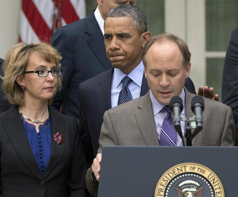President Barack Obama arrives to participate in a news conference in the Rose Garden of the White House, Wednesday, April 17, 2013, in Washington, about measures to reduce gun violence. With tObama is former Rep. Gabby Giffords, left, and Mark Barden, the father of Newtown shooting victim Daniel.  (AP Photo/Carolyn Kaster)