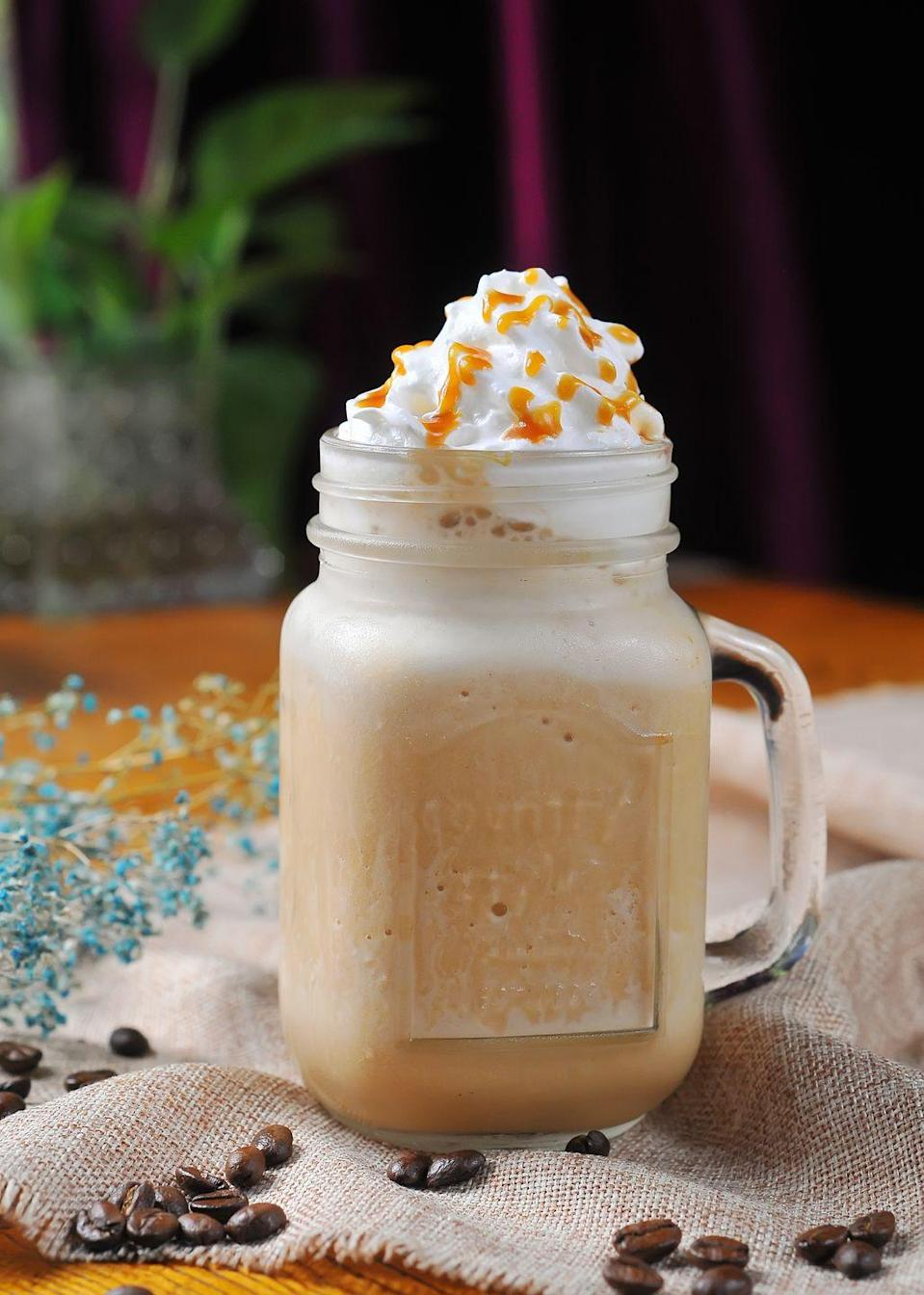 "<p>More dessert than coffee, the Frappuccino is a Starbucks classic — a blended concoction of milk, sugar, coffee and ice, topped with whipped cream and flavored syrups. </p><p><strong>Pro tip: </strong>Although there are dozens of variations, the vanilla, mocha, and caramel versions are all easy to make at home.<strong><br></strong></p><p><a href=""https://www.delish.com/cooking/recipe-ideas/a32816778/starbucks-caramel-frappuccino-copycat-recipe/"" rel=""nofollow noopener"" target=""_blank"" data-ylk=""slk:Get the recipe for Frappuccino from Delish »"" class=""link rapid-noclick-resp""><em>Get the recipe for Frappuccino from Delish »</em></a><br></p>"